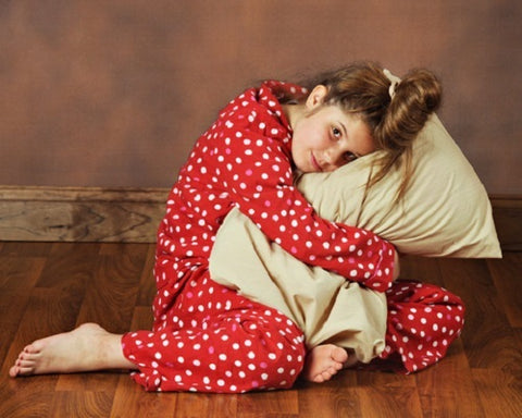 Young girl hugging A Little Pillow Company standard size pillow
