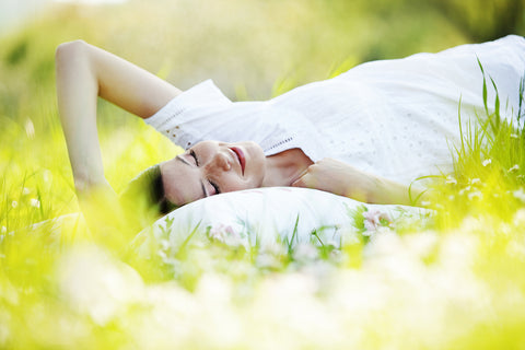 Woman relaxing on A Little Pillow Company pillow