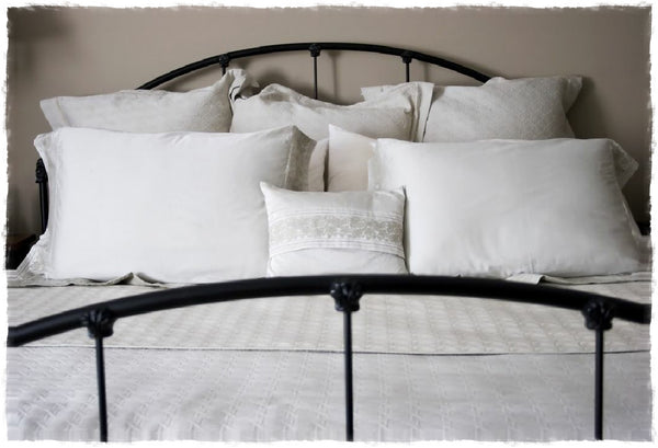 Bed of sustainable, eco-friendly pillows from A Little Pillow Company. Made in the USA