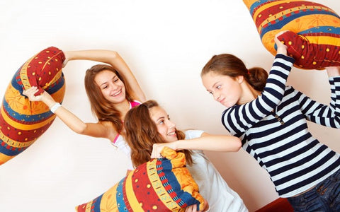 Teen girls having a pillowfight with A Little Pillow Company standard size pillows