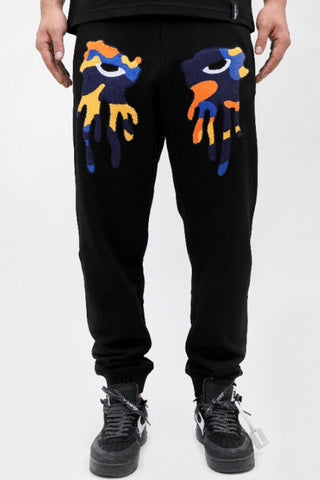 ROKU STUDIO ORANGE CAMO TEAR DRIP SWEATPANTS BLACK