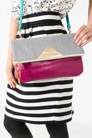 Convertible crossbody clutch in fuchsia