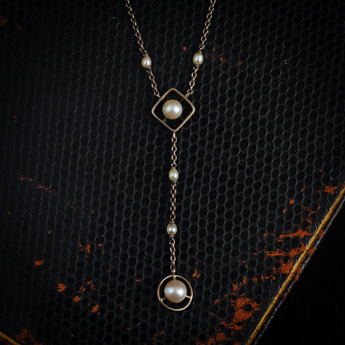 An Antique Platinum and Natural Pearl Lavaliere Pendant