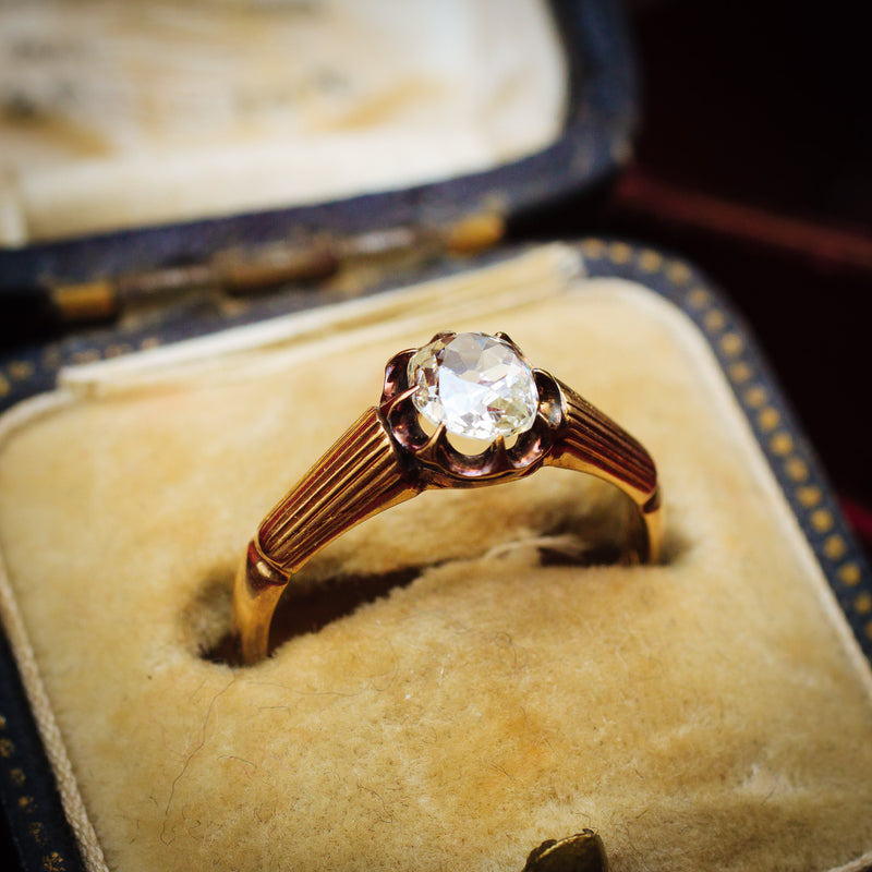 Captivating Antique Cushion-cut Diamond Solitaire Engagement Ring