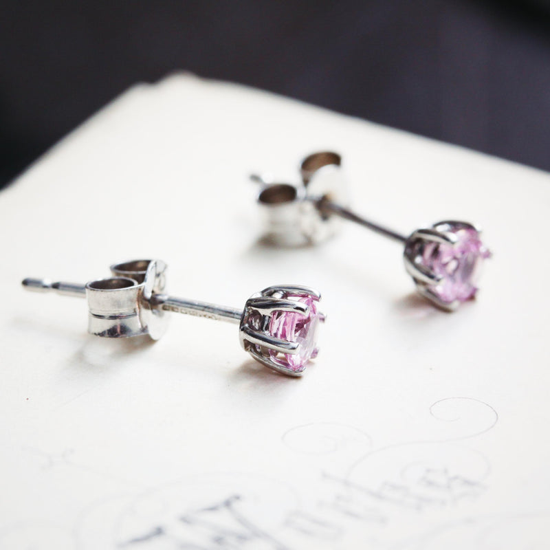 A contemporary pair of twinkly blush pink Topaz gems mounted as earrings in 18ct white Gold. A very pretty colour, a nice quality pair of stud earrings to wear centrepiece or as a collection in multiple piercings.