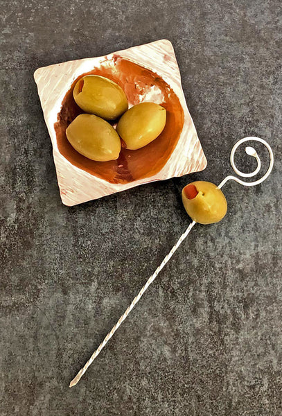 skewer and 3 inch copper bowl with olives