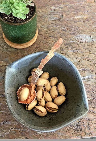 copper leaf spoon with pistachio nuts