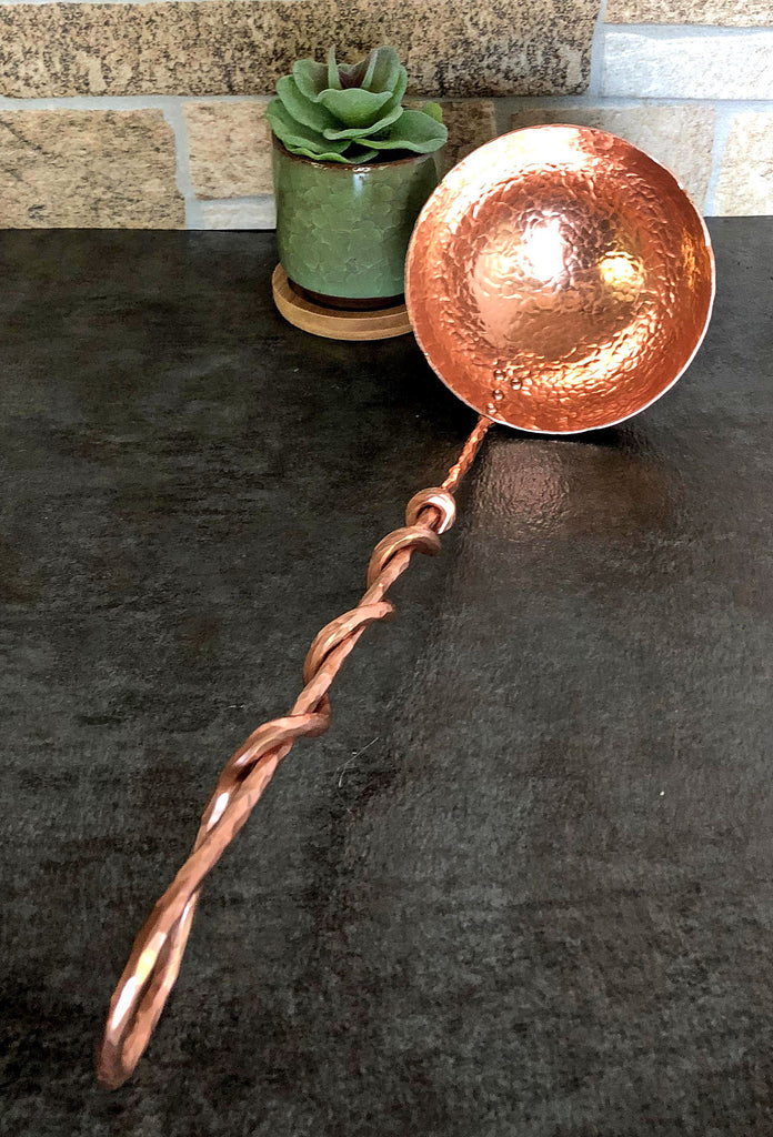 large copper ladle