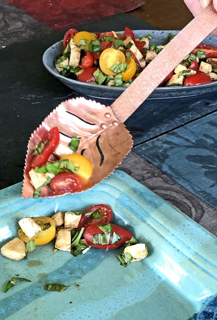 rose leaf slotted spoon serving marinated tomatoes