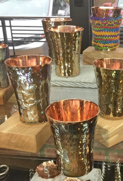 copper and silver shot glass in a shop