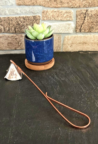 silver candle snuffer with copper handle