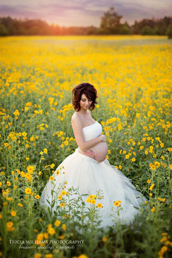 Pregnant mother wearing the Helena Tutu Set in ivory by Sew Trendy Accessories in a field of flowers.