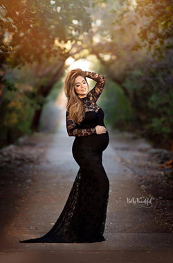 Pregnant woman in the Selena Gown Set in Black by Sew Trendy Accessories standing in front of trees.