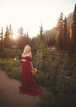 Expecting mother wearing the aspen gown in brick by Sew Trendy standing in Forrest near Mt. Rainier.