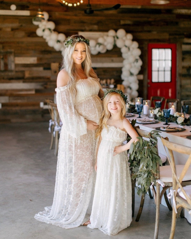 Expecting mother wearing the Valerie gown in ivory by Sew Trendy standing with her daughter in our katie gown