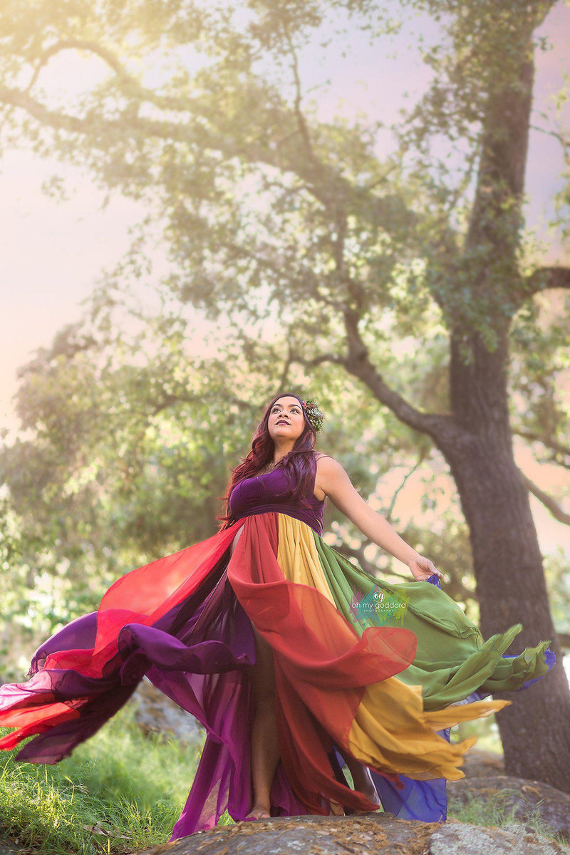 Pregnant woman in the Miracle Gown in Jewel Tones by Sew Trendy Accessories swirling in the woods.
