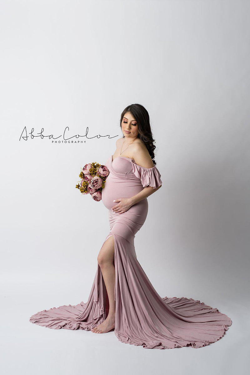 Expecting mother wearing the Serenity in mauve by Sew Trendy standing on white backdrop in studio