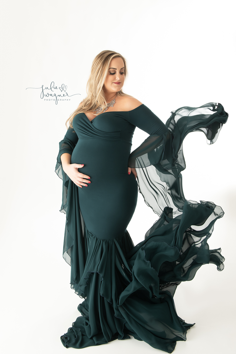 Beautiful pregnant woman wearing the Allura gown in Blue Spruce by Sew Trendy