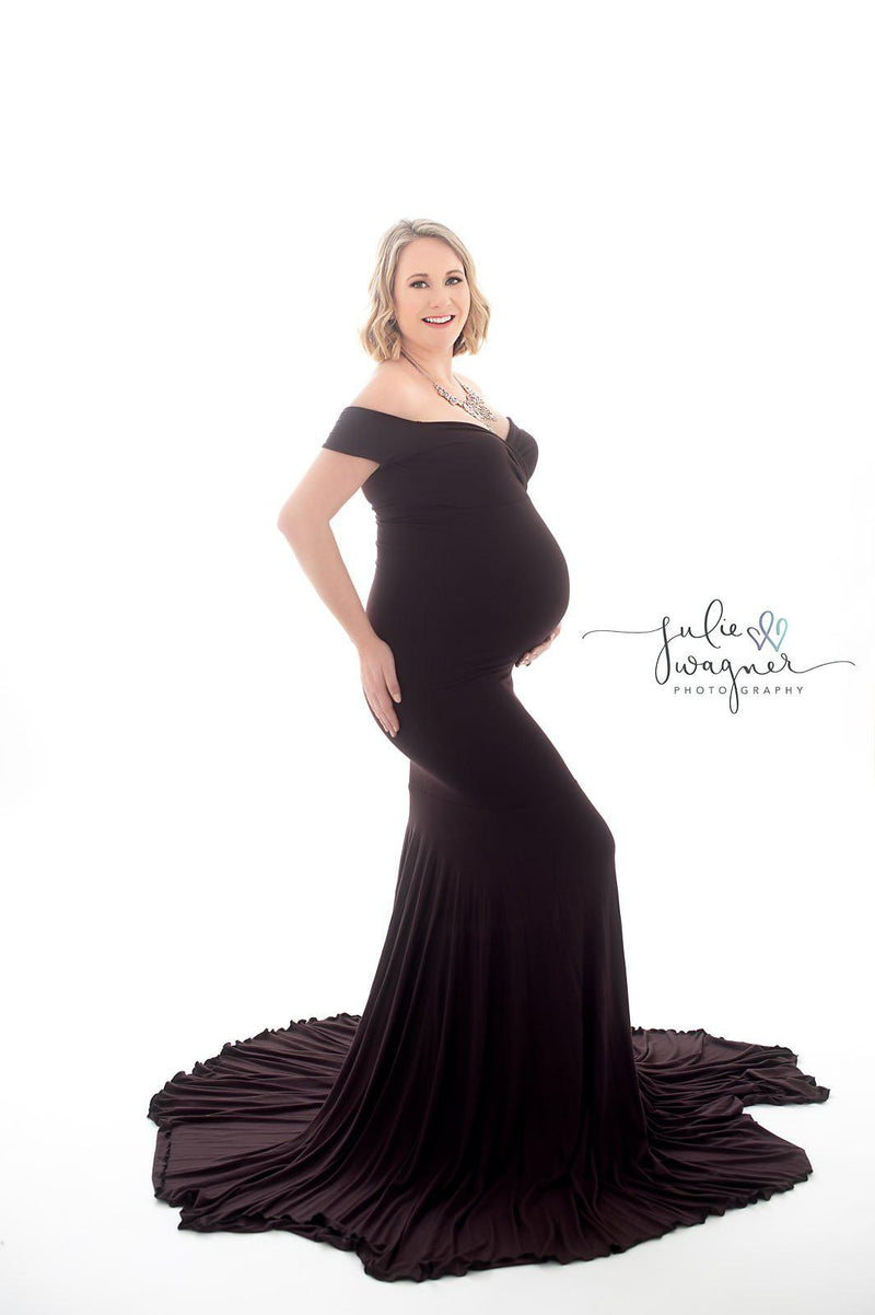 Glowing expecting mother wearing the allysa gown by Sew Trendy in Truffle on a white backdrop.