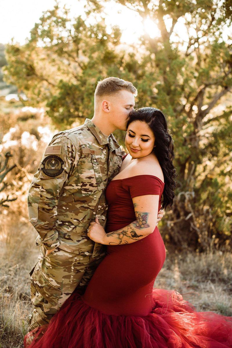 Pregnant mother and military couple in the Jacqueline Gown in brick by Sew Trendy Accessories.