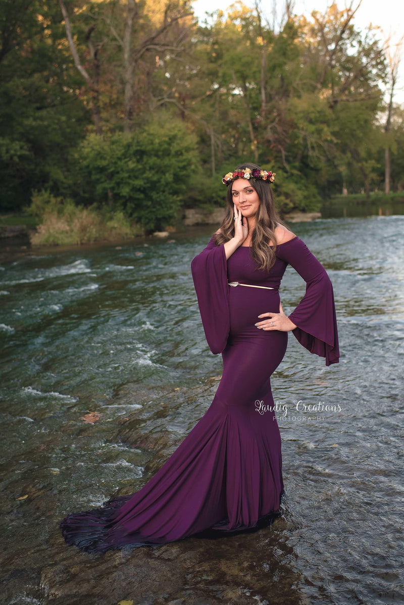Pregnant mother in the Meredith Gown in Plum by Sew Trendy Accessories standing in water.