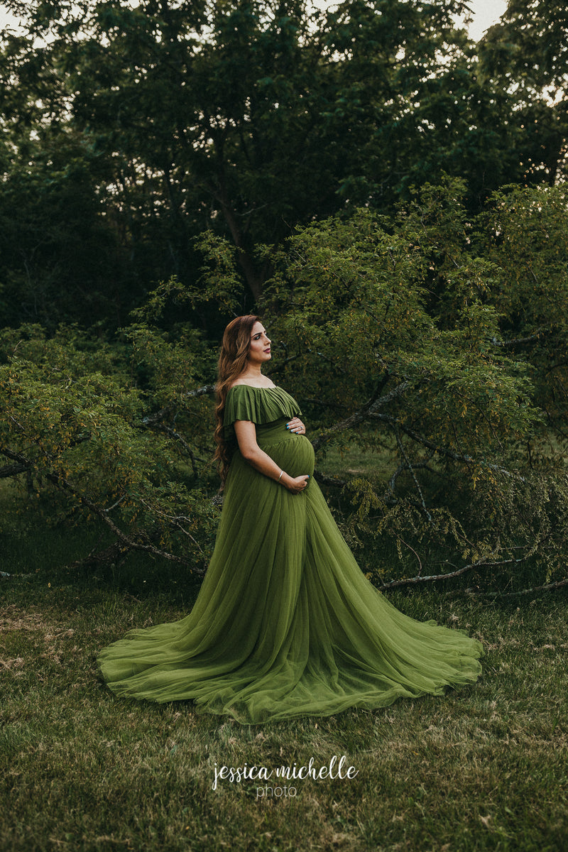 Enchanting pregnant woman wearing the Willow by Sew Trendy layered over the Valentina bodysuit standing in forest.