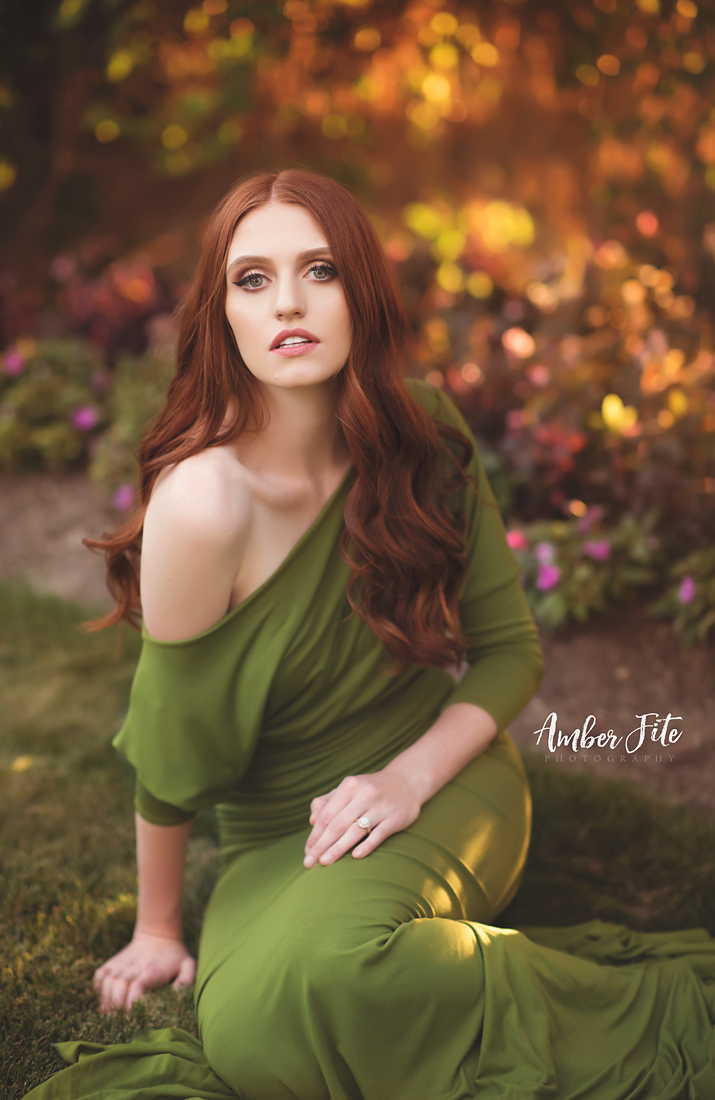 Red headed model in the Jaden Gown in Moss by Sew Trendy Accessories in a garden.