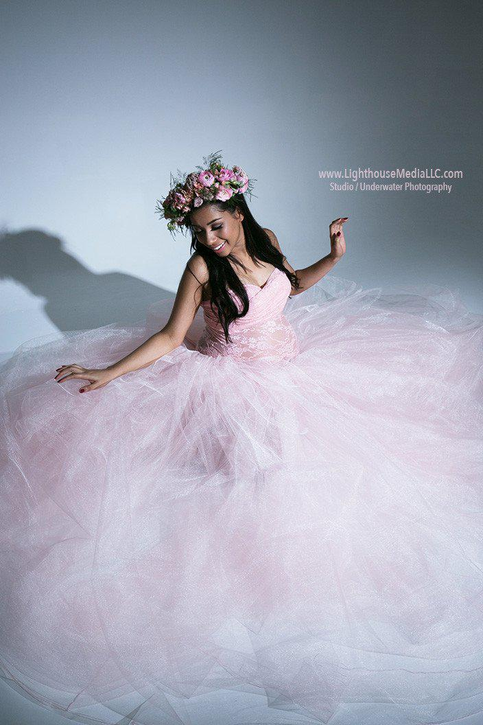 Pregnant woman in the Morgan Tutu Set in Blush by Sew Trendy Accessories sitting on a grey background in the studio.