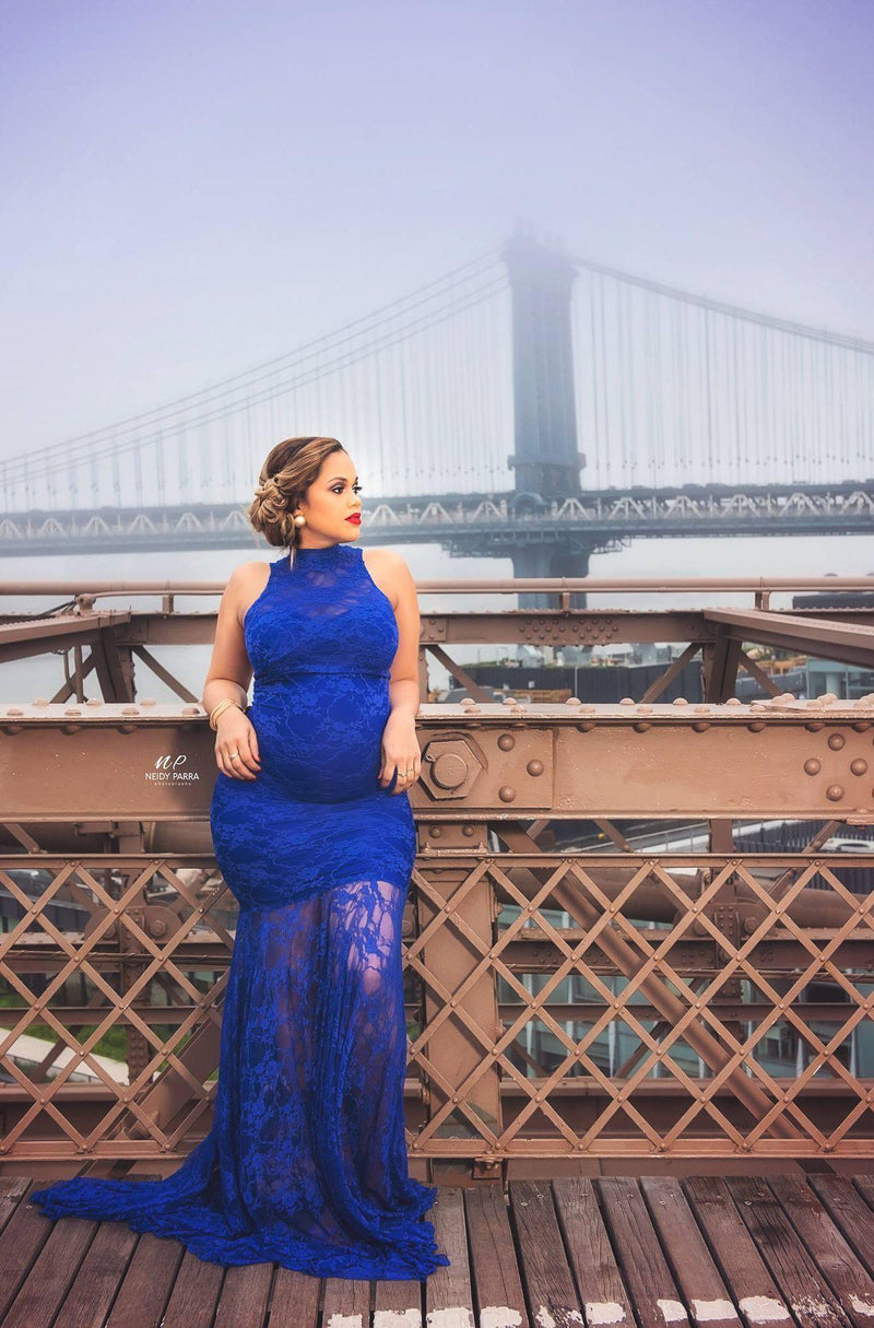 Pregnant woman wearing the Catalina gown in royal blue by Sew Trendy standing on bridge