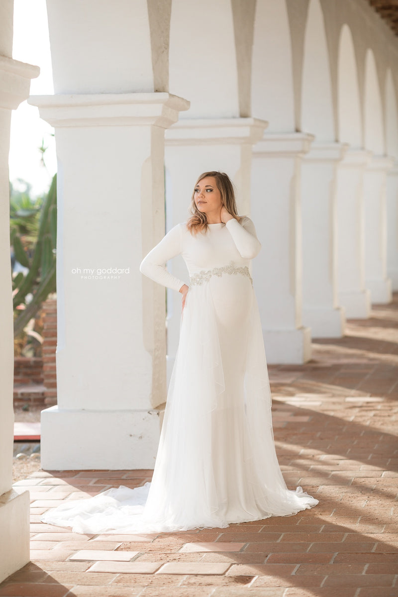 Beautiful pregnant woman wearing the Ravenna bridal mesh cape over her Sew Trendy gown in White