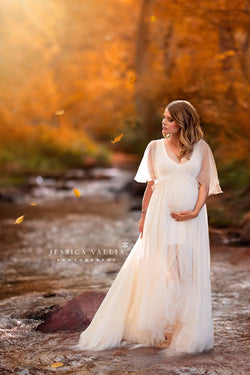 Pregnant woman wearing Winefred in ivory by Sew Trendy standing on autumn forest path