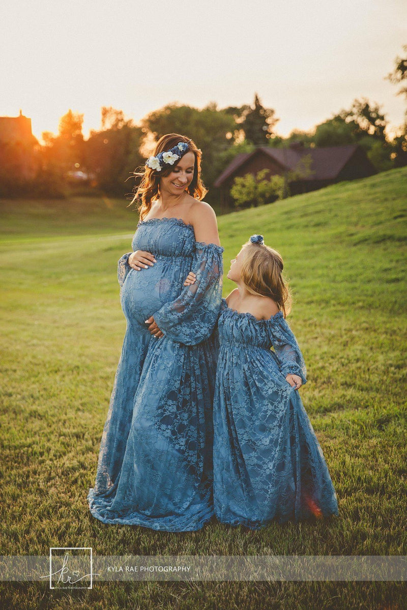 Expecting mother wearing the Valerie in steel blue by Sew Trendy with her daughter wearing a matching gown