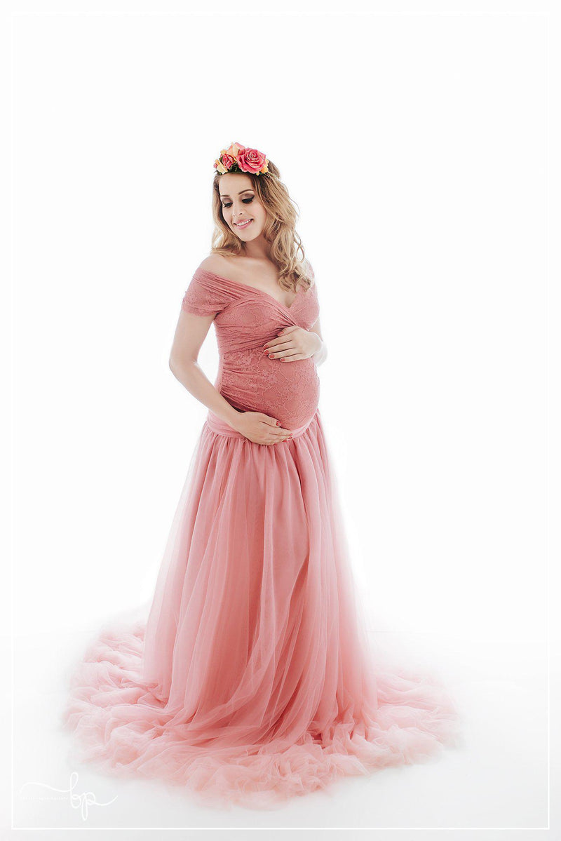 Beautiful pregnant woman wearing the Willow skirt by Sew Trendy standing in backlit studio.