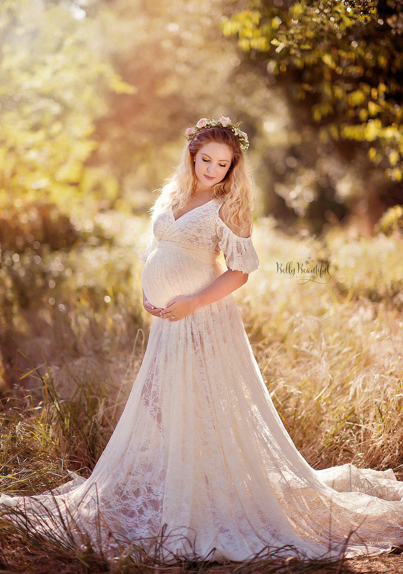 Beautiful pregnant woman wearing the Angelica skirt by Sew Trendy, standing in a field at springtime.