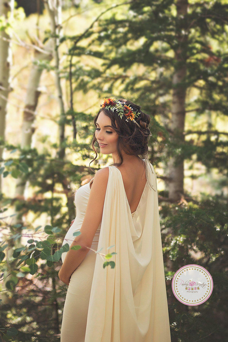Expecting mother wearing the Hera gown in Ivory in a forest by Sew Trendy Accessories with a flower crown.