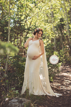 Expecting mother wearing the Hera gown in Ivory in a forest by Sew Trendy Accessories