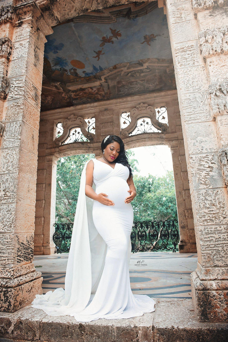 Expecting mother wearing the Hera gown in White by Sew Trendy Accessories with a flower crown.
