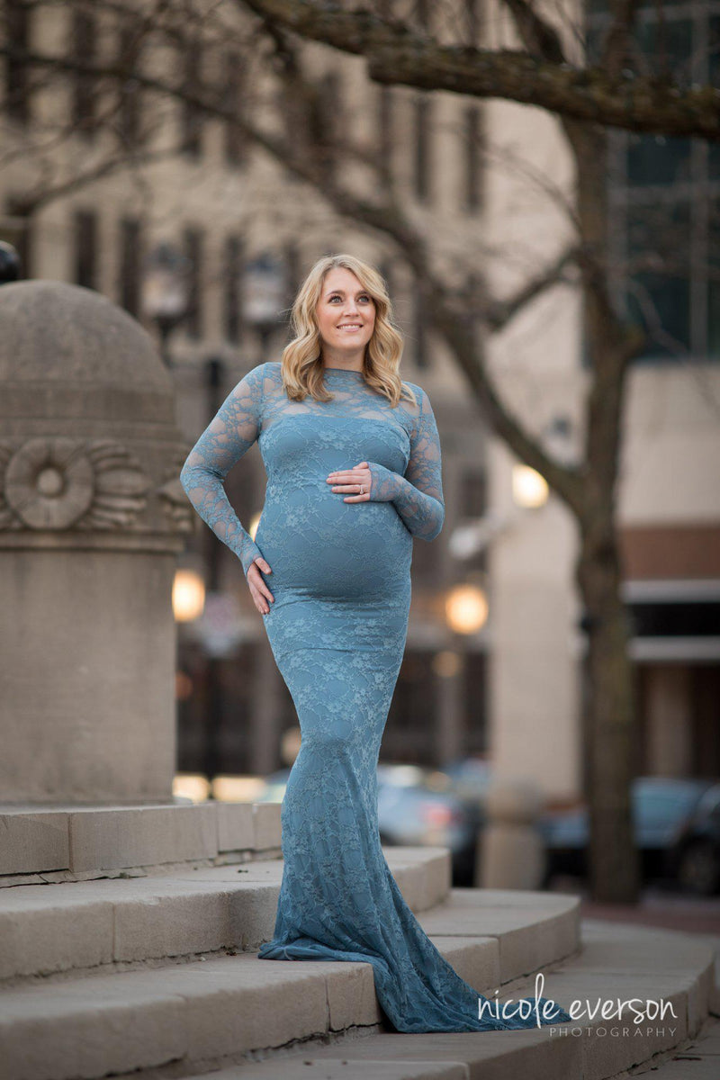 Pregnant woman in the Selena Gown Set in Blue Steel by Sew Trendy Accessories standing on stone steps in a city.