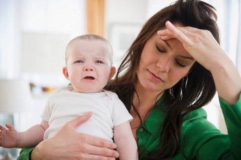 mother stressed with crying baby