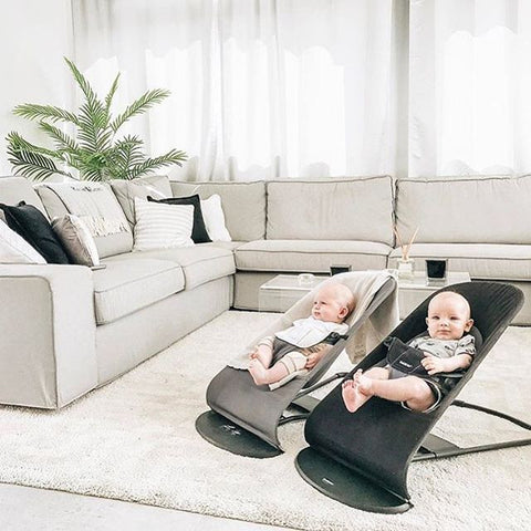 Two newborn babies in Baby Bjorn bouncers