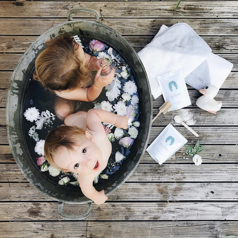 babies in outside bath tub