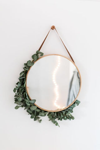 Circle mirror with scandi leaves around
