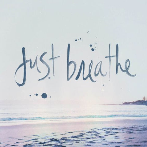 Just breathe typography with sea in the background