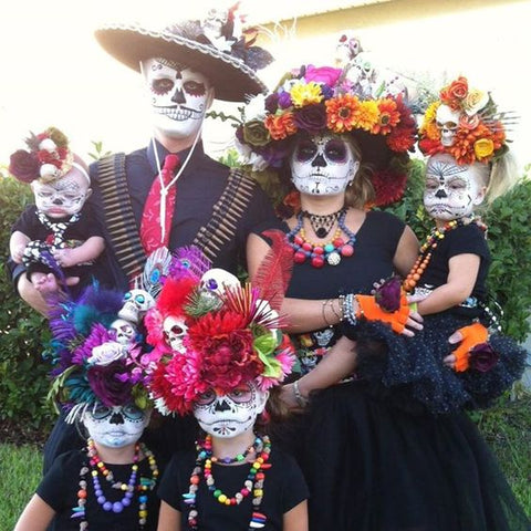 family dressed as day of the dead