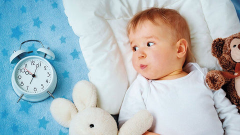 baby looking at clock awake