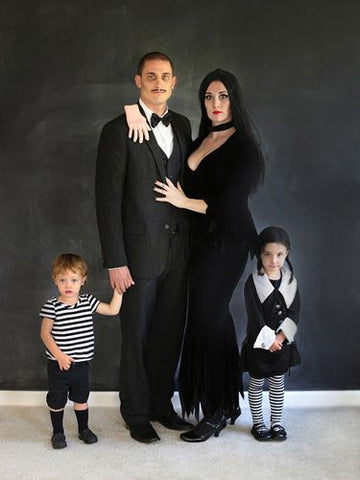 family dressed as the addams family