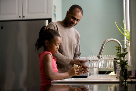 dad with daughter in the kitchen