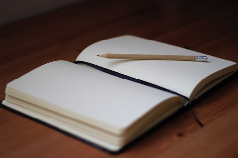 diary notebook with pencil on it