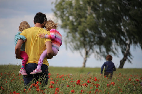 dad with children in the field