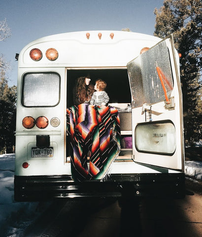 Baby and mother in wilderness bus wearing mori organic baby clothes